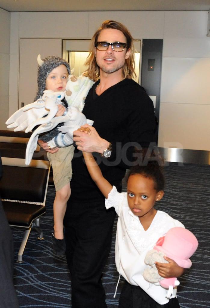 Brad Pitt took care of Knox and Zahara Jolie-Pitt at the airport.