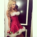 Was Paris Hilton naughty or nice this year? This dress suggests both. Source: Instagram user parishilton