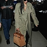 Kim Kardashian Wearing a Low-Cut Shirt at the Airport