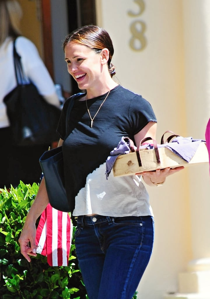 Jennifer Garner was spotted out and about with her two daughters in LA on Tuesday afternoon. The actress — who recently returned from London — flashed her signature smile as she carried a wooden tray while walking on the sidewalk. This is the latest we've seen of the star since reports surfaced that estranged husband Ben Affleck wants to get back together with her. While Jennifer has yet to address the rumor, she has been smiling a whole lot lately.