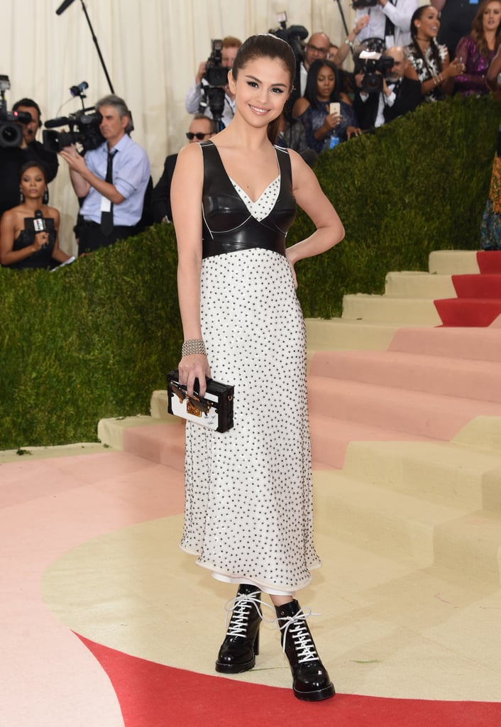 Selena Gomez drew eyes when she arrived at the Met Gala on Monday. The singer, who was days from kicking off her Revival tour, was all smiles as she strutted her stuff on the red carpet and showed off her white polka dot dress complete with a leather vest, paying homage to the ball's Manus x Machina theme. Also on hand for the event was Selena's BFF, Taylor Swift, who is one of the Met Gala cochairs along with Idris Elba. Keep reading for more of Selena's night, and then check out all the star-studded arrivals.