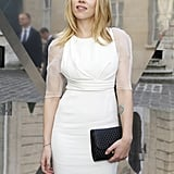 Scarlett Johansson wore a white Dior dress with sheer sleeves to attend the Tod's party in Paris.