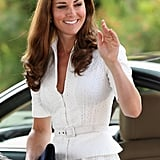 Kate Middleton wore a white dress with a belted jacket to visit the Gardens by the Bay in Singapore.
