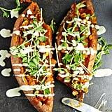 Korma-Stuffed Sweet Potatoes With a Garlic Tahini Dressing