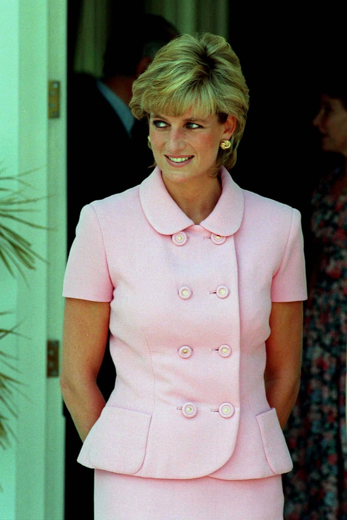 For a 1995 trip to Argentina, Diana channelled Jackie O in a pastel pink Versace skirt suit.