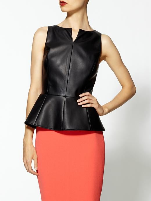 If you're looking for an affordable leather-like option, this is it. Let the sharp seams do all the talking in this streamlined black top. Tinley Road Vegan Leather Peplum Top ($98)