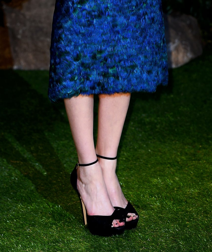 Michelle finished her look via black ankle-strap Jimmy Choo sandals.