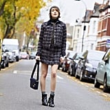Give a Preppy Tweed Skirt Suit a Modern Twist by Pairing It With a Turtleneck, a Hat, and Booties