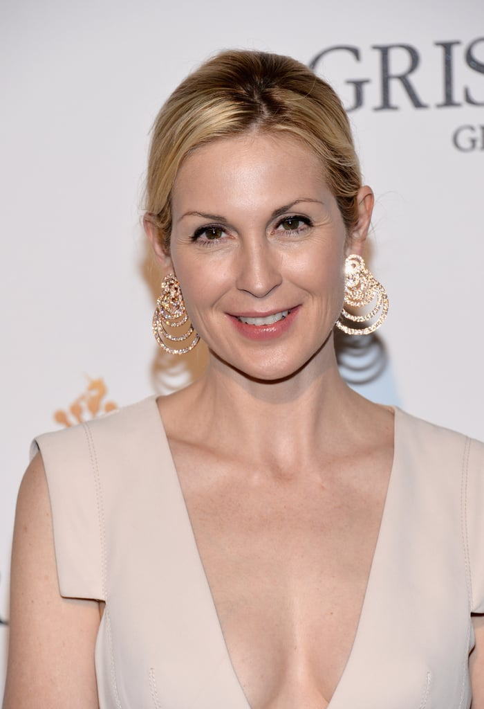 Kelly Rutherford accessorised her creamy gown with megawatt gold earrings.