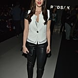 Jessica Lowndes attended a fashion show in Toronto looking tough in a pair of black leather pants and a black and white blouse topped with a white vest.