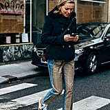 You can wear your favorite coat with a pair of cool trousers and colorful sneakers to mix things up.