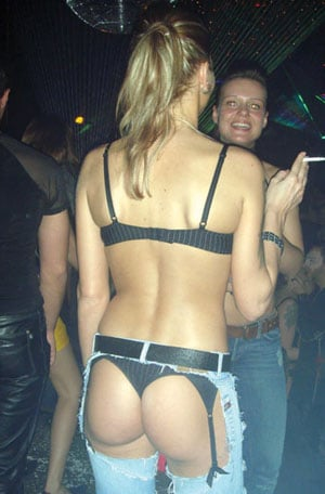Sexy girl in assless chaps