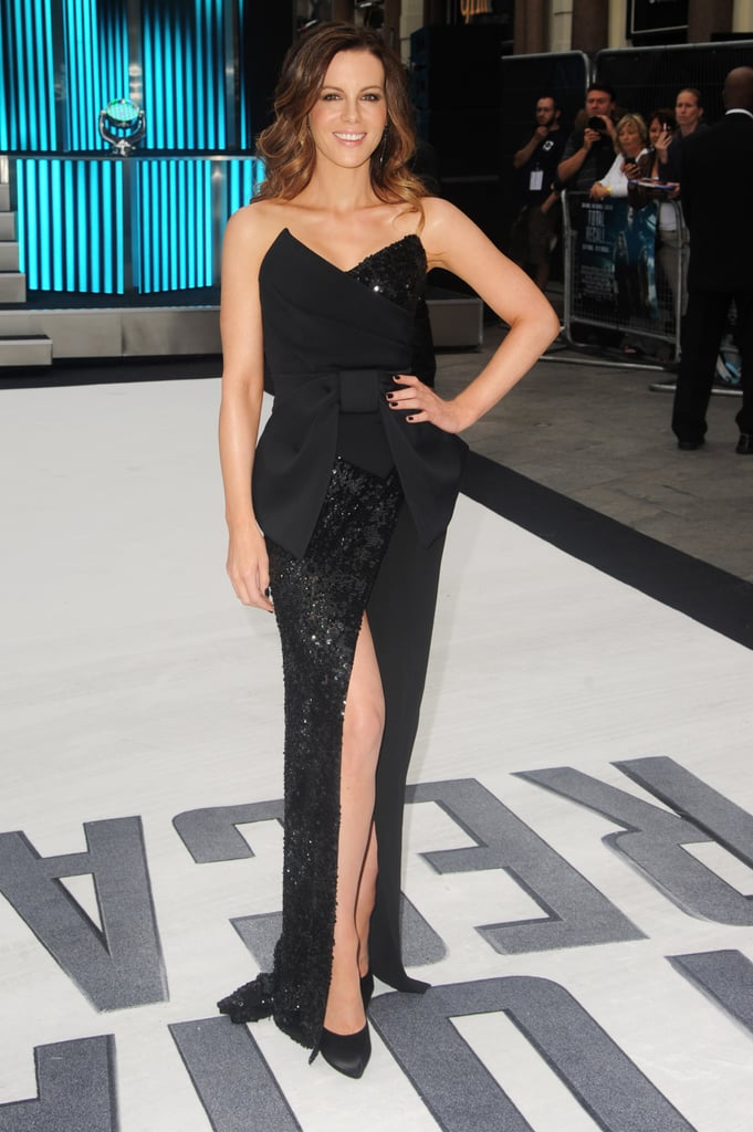 Kate Beckinsale showed off a little leg at the UK premiere in a sequin-embellished thigh high-slit Donna Karan dress. To complement the glam gown, she wore her hair loose and wavy with minimal accessorizing.