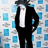 Who's under the head? Why, it's only Hugh Grant at the 2014 UNICEF Halloween ball.
