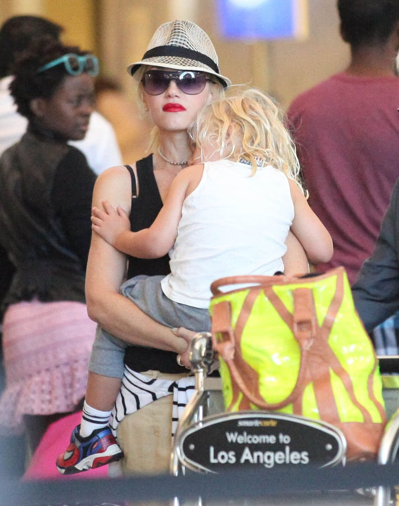 Gwen Stefani held Zuma while he slept at LAX.