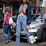 With jeans as the base, you can go casual or bold on top. We love this cropped blazer look on Madelynn Furlong.