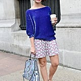 Sweet pleats emboldened with a glam top, Stella McCartney bag, and printed loafers.