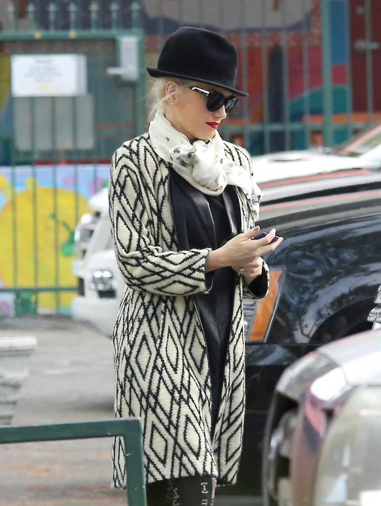 Gwen Stefani bundled up in a printed coat.