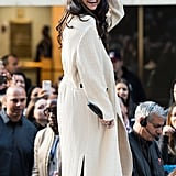Fall staple: a quilted ivory duster. Selena wore it with: a black cutout Roland Mouret jumpsuit when she performed on the Today show in New York in October 2015.