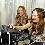 Lauren Conrad checked up on the DJ at Fashion's Night Out.