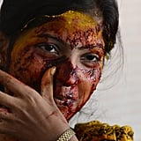 A female teacher was smeared with vegetable paste made from beetroot, turmeric, spinach, and coriander during Holi celebrations at a city civic school in Mumbai, India.