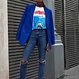 Keep it casual with distressed skinnies and a graphic tee. Add a pair of brightly coloured sneakers and a beanie, but keep up the elegance factor with a blazer draped over your shoulders.