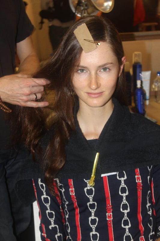 """""""Derek wanted something that wasn't referenced from the past,"""" said lead hairstylist Orlando Pita for Beauty.com. """"This look is a very modern, urban woman because the collection has a lot of sportswear."""" To achieve this modern-day effect, he used Phyto Intense Volume Mousse ($24) to get that airiness and separation."""