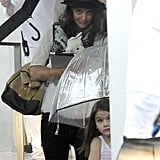 Katie Holmes and Suri Cruise ventured out into the Miami rain.