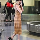 Emma Roberts Black Pearl Pumps in Airport