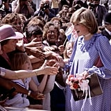 Princess Diana held hands with onlookers while opening a community centre in London in May 1982 — her last official engagement before Prince William's birth.