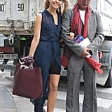 A charming duo, thanks to a breezy sheer maxi, rich burgundy satchel, and very dapper look from him.