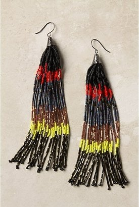 Wear these standout danglers with an all-black ensemble.  Anthropologie Striated Tassel Earrings (488)