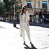 White and cream pairings look luxe enough as is, so slipping on sliders doesn't take away from the cool-girl appeal.