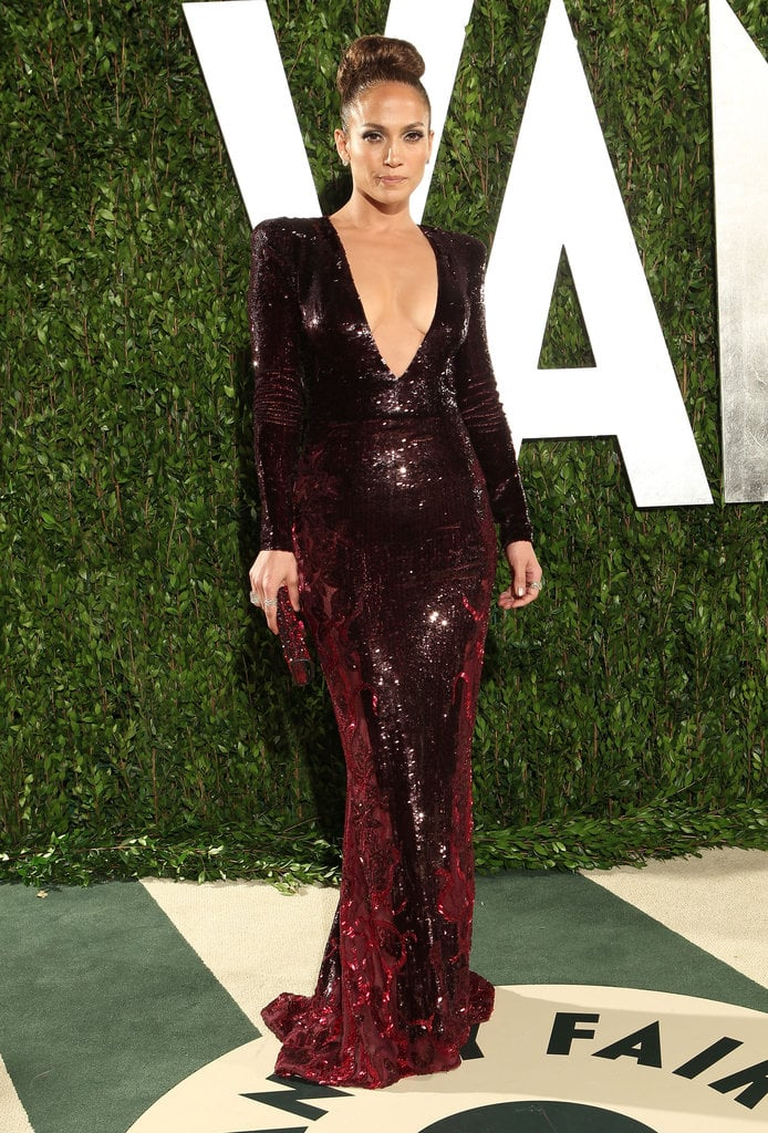 Later in the evening, Jennifer Lopez slipped into a dark crimson Zuhair Murad sequined gown showed off a daring amount of decolletage.