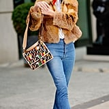 Rosie Huntington-Whiteley added a pop of color to her outfit with red boots and a Fendi bag.