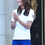 On July 26, Kate welcomed the torch to Buckingham Palace wearing official Adidas Team GB apparel.