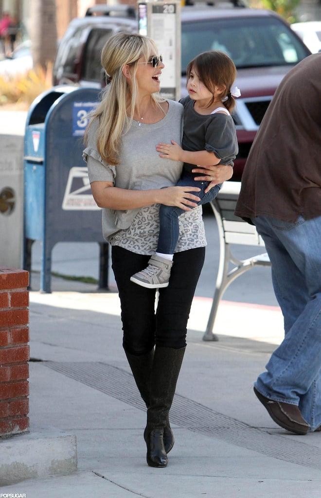 "Sarah Michelle Gellar stepped out for the first time since giving birth to her second child in LA yesterday. She wore a leopard-print top and black boots and carried her daughter, Charlotte, to their waiting car during the outing. SMG gave birth to a boy in September, and while she and husband Freddie Prinze. Jr didn't announce the baby's name, they did share that Charlotte was ""very excited"" to be a big sister. The new addition was just one more reason to celebrate after SMG and Freddie marked their 10th wedding anniversary earlier last month."