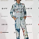 At the 2019 Busan International Film Festival, Timothée boldly wore matching, paint-splattered overalls and a shirt by artist Sterling Ruby.