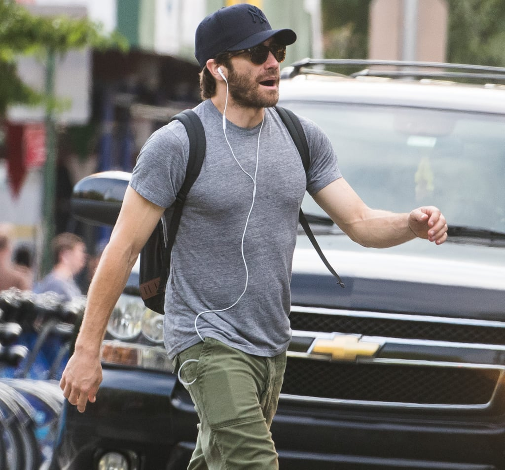 "Jake Gyllenhaal was all smiles during a walk in NYC on Wednesday. The actor put his bulging biceps on display in a tight grey tee and made his way down the street wearing earbuds and a sweet grin — we're dying to know: was he on the phone with a friend? Tuning in to a podcast? Listening to Justin Timberlake's catchy new song? Jake's casual outing comes just days after he attended the Tony Awards on Sunday. In addition to his dapper red carpet appearance, he also hit the stage for an impressive impromptu performance of the Disney classic ""A Whole New World"" with Sean Hayes and host James Corden. Is there anything Jake can't do?"