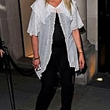 Jo Wood wore a long white blouse over her black ensemble.