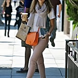 Jessica Alba outfitted a Spring-worthy denim look in pastel jeans, a bright crossbody bag, and a pair of Elizabeth and James colored shades.