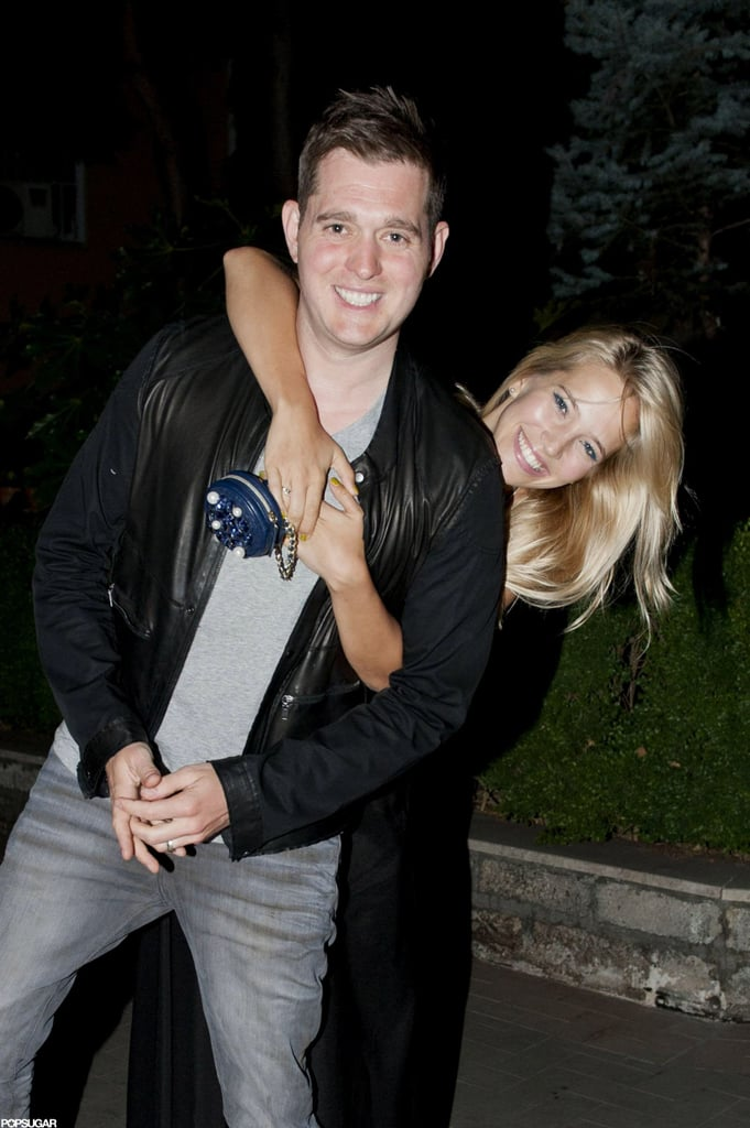 Michael Bublé and his wife of one year, Luisana Lopilato, dined out at Parioli in Rome on Sunday. The couple stopped to smile and pose for the cameras as they headed out of the restaurant. Michael and Luisana celebrated their first wedding anniversary on March 31 and have been on the go ever since. Michael toured Europe and South Africa throughout April and May. He's since switched gears to his new role as an advisor to Blake Shelton's team on The Voice. Luisana, meanwhile, has been busy modeling for Ultimo and recently showed off their latest lingerie line.