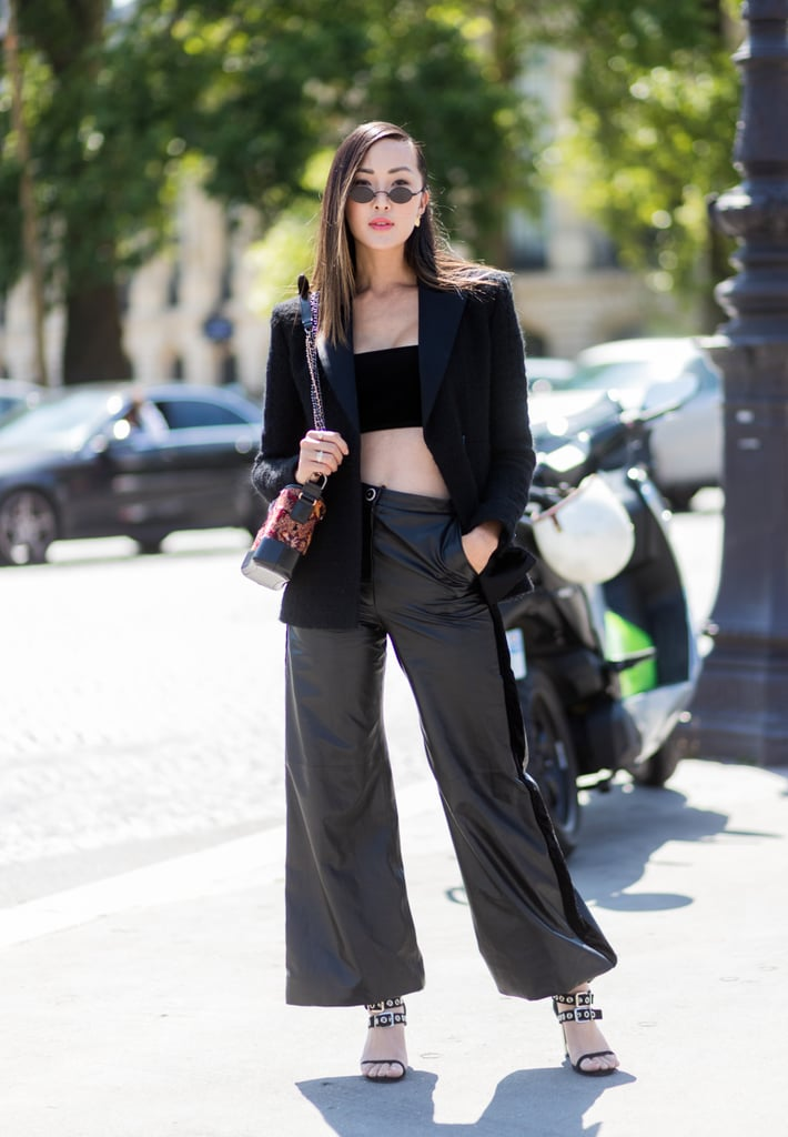 An afterwork-hours outfit that consists of a bandeau top, blazer, slouchy trousers, and buckle heels.