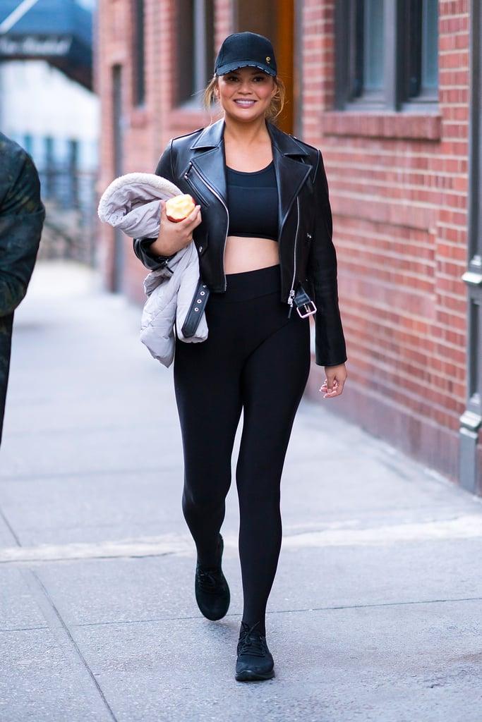Chrissy Teigen Wearing Leggings and a Leather Jacket