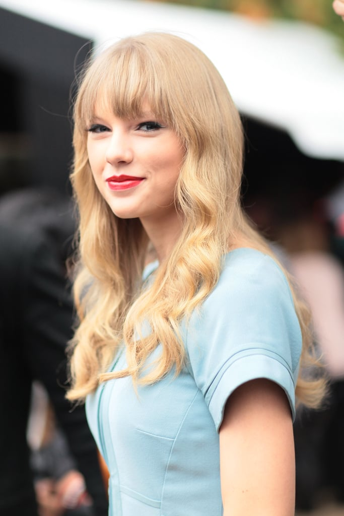 Taylor Swift showed off a red lip on her way from show to show.