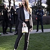 Wearing a Tailored Suit With a Dior Bag