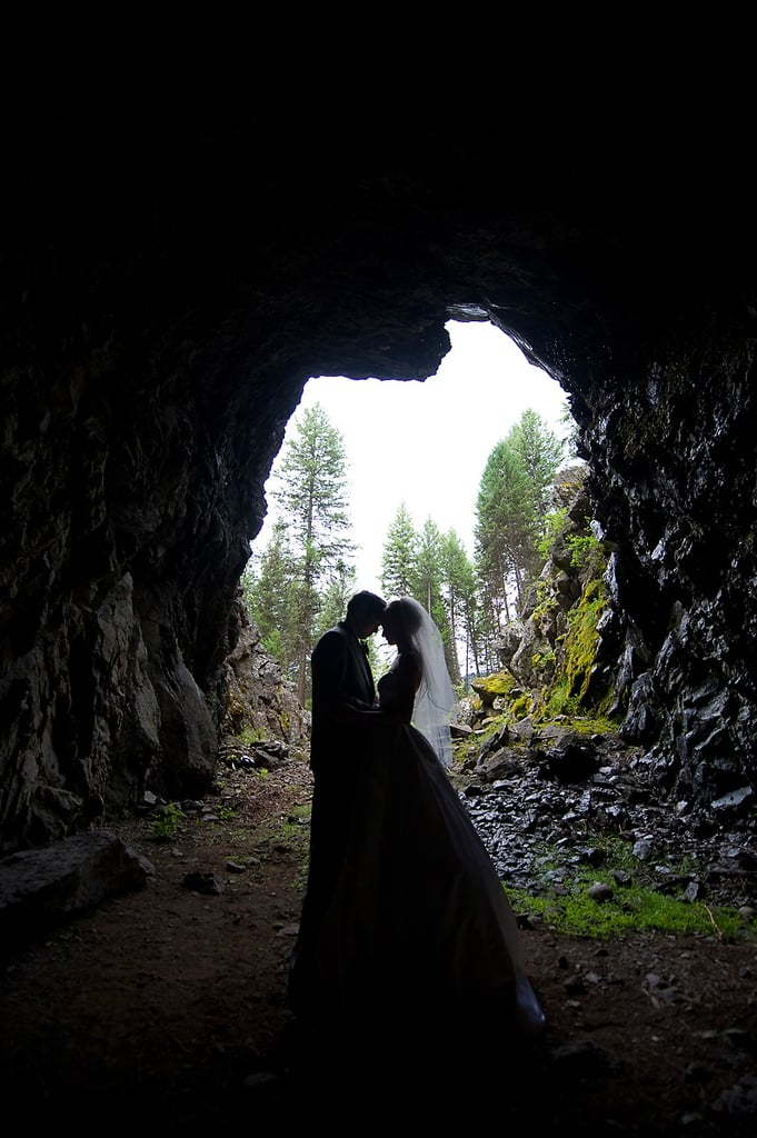 "Paige and Kelvin said their ""I dos"" in the middle of a forest in the mouth of an abandoned train tunnel in British Columbia. See the wedding here!"