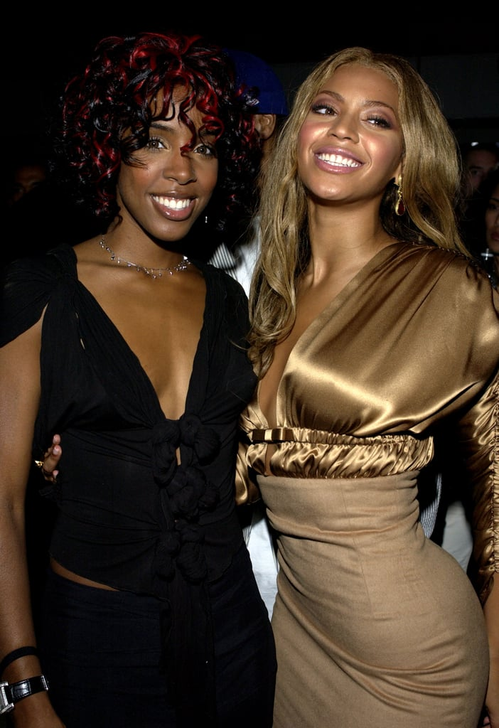 Kelly and Bey posed for a photo to celebrate the release of Beyoncé's debut album, Dangerously in Love, in 2003.