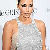 At the De Grisogono party, Kim wore superdramatic winged liner, leaving the rest of her face neutral.