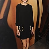 Alexa Chung decided on a Miu Miu black silk crepe dress with crystal embellishments and finished that she paired with black loafers.